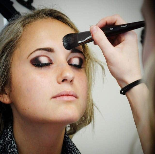 A makeup artistry student works her magic at the International Beauty Institute