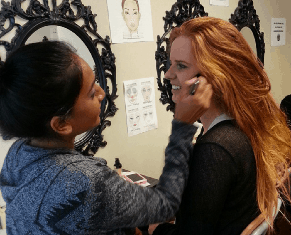 Students take turns in the client's chair in makeup artistry classes at IBI