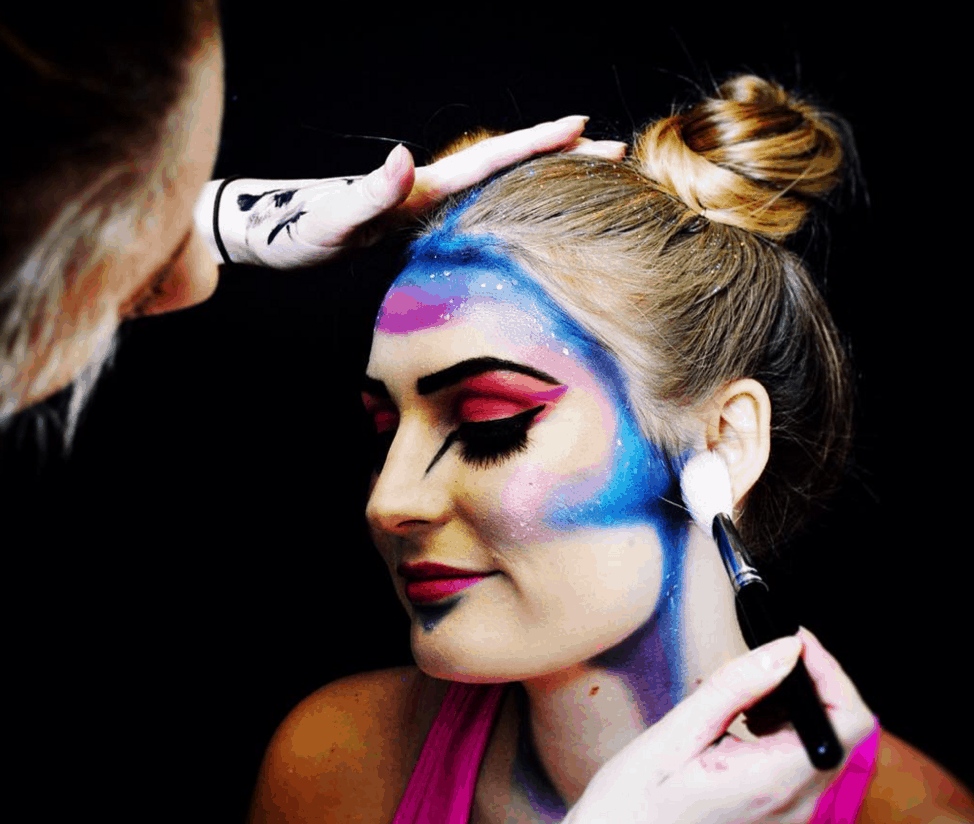An IBI student and model prepare for a creative 'space creature' photo shoot