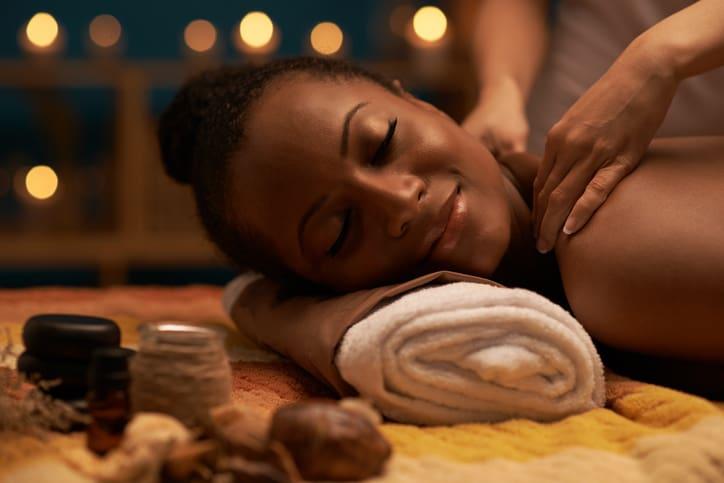 Hands of specialist massaging patients nape of neck