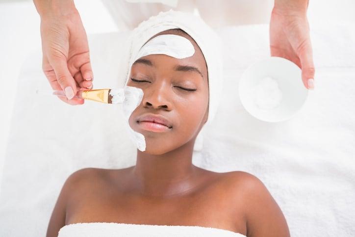 Pretty woman getting a facial treatment at the health spa