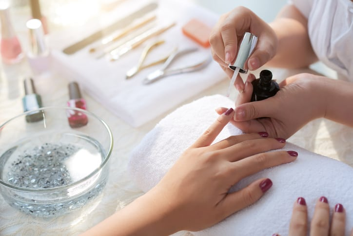 Close-up image of woman having her nails done in beauty salon