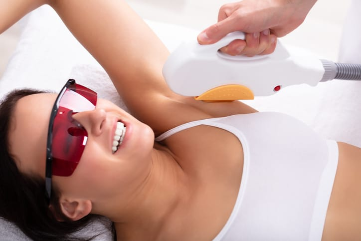 Beautiful Young Woman Having Underarm Laser Hair Removal Treatment In Spa