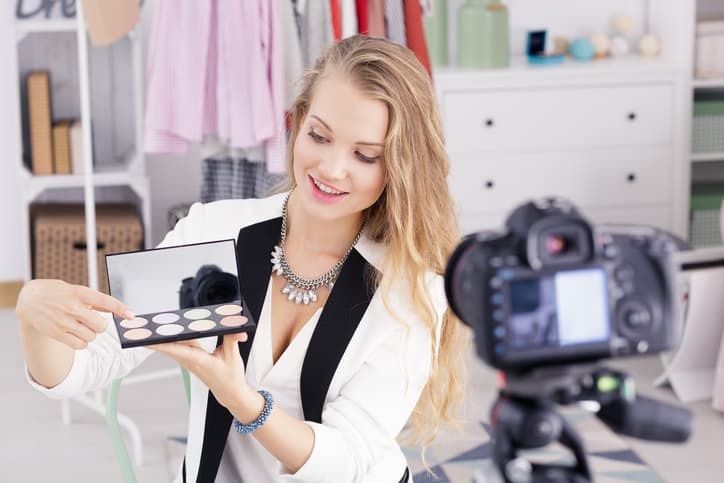 Young female make up vlogger recording broadcast