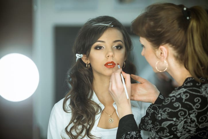 Professional expert, makeup artist prepares very beautiful, young, well-known, glamorous, stunning model for filming shooting for cover of fashion magazine VOGUE, does make-up, makes up lips, art,eyes, white. Professional master,makeup artist does cute,fashion,creative make-up, makes up, eyes,lips. Beautiful,fashionable,glamorous,famous,nice,attractive,pretty,sexy celebrity,model,lady,girl,woman prepare for shooting.Nice face,pure,clean skin.Cosmetics.Salon.