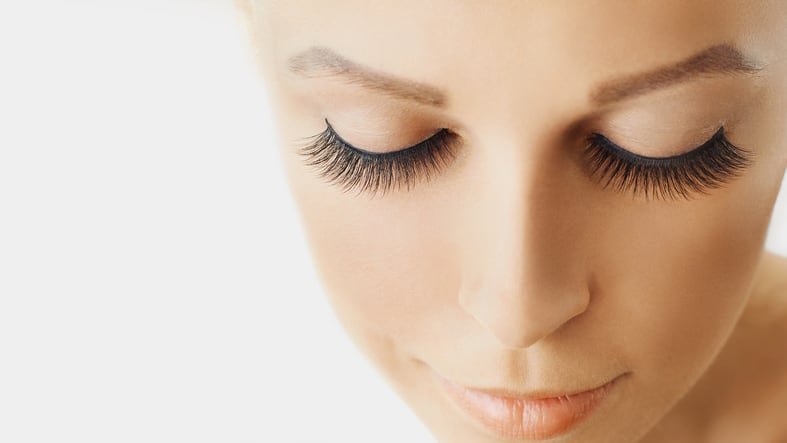 Eyelash extensions, cosmetology, beauty and skin care. Close up, macro with copy space